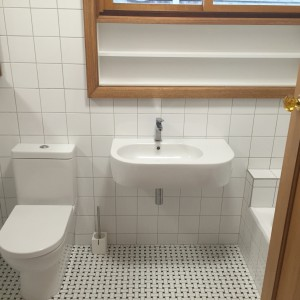bathroom with attached toilet